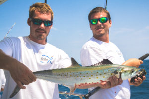 Two of the mates showcasing a beautiful Spanish Mackerel